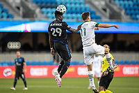 SAN JOSE, CA - SEPTEMBER 16: Jaroslaw Niezgoda #11 of the Portland Timbers & Jacob Akanyrige  #29 of the San Jose Earthquakes battle for the ball during a game between Portland Timbers and San Jose Earthquakes at Earthquakes Stadium on September 16, 2020 in San Jose, California.