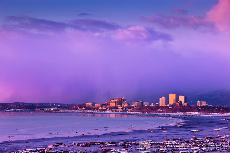 Anchorage Skyline catches the last rays of sun at sunset as seen in this photo from Earthquake park, late winter, Southcentral Alaska, USA.