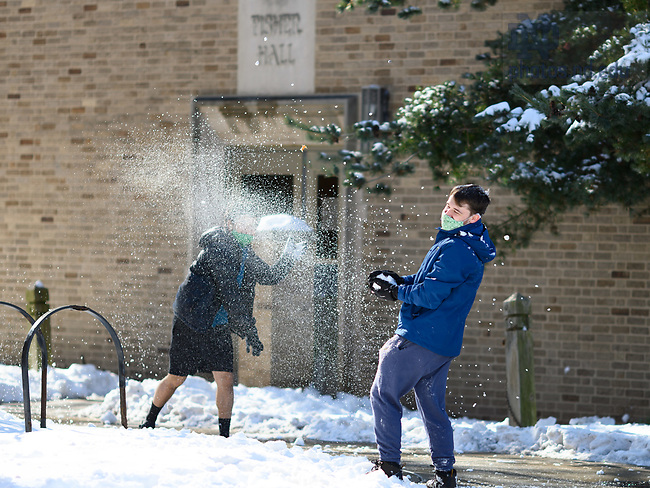 February 1, 2021; Students throw snowballs outside Fisher Hall (Photo by Matt Cashore/University of Notre Dame)