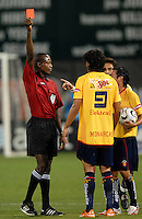 Referee Courtney Campell gives a red card to Monarcas Morelia Luis Landin (9) after pushing DC United defender Bobby Boswell (32) in the back after a foul.  Monarcas Morelia tied DC United 1-1 in  the SuperLiga opening match in group B, at RFK Stadium Washington DC, Wednesday July 25, 2007.