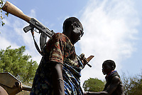 ETHIOPIA, Southern Nations, Lower Omo valley, Kangaten, village Kakuta, Nyangatom tribe, water pump at dry river Kibish, shepherds carry Kalashnikov AK-47 machine guns to protect themselves from cattle raids of Turkana tribe  / AETHIOPIEN, Omo Tal, Kangaten, Dorf Kakuta, Nyangatom Hirtenvolk, Wasserpumpe am trocknen Fluss Kibish, Hirten tragen Kalaschnikow AK-47 Maschinengewehre zum Schutz vor Viehdiebstaehlen durch Turkana Voelker