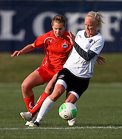 Beverly Goebel of the Washington Freedom fights for the ball with Caroline Seger of the Philadelphia Independence during their preseason game at the Maryland SoccerPlex in Germantown, Maryland.