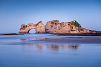 Blue light after twilight on Wharariki Beach with famous arches on west coast of South Island, Nelson Region, South Island, New Zealand, NZ