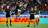 Sevu Reece of New Zealand (All Blacks) and Makazole Mapimpi of South Africa jump for the high ball during the Rugby World Cup Pool B match between the New Zealand All Blacks and South Africa Springboks at the International Stadium in Yokohama, Japan on Saturday, 21 September, 2019. Photo: Steve Haag / stevehaagsports.com