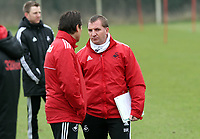 Swansea City FC, training session, Llandarcy, Swansea, 16/03/12<br /> Pictured: Manager Brendan Rodgers speaks with Assistant Coach Colin Pascoe.<br /> Picture by: Ben Wyeth / Athena Picture Agency<br /> info@athena-pictures.com