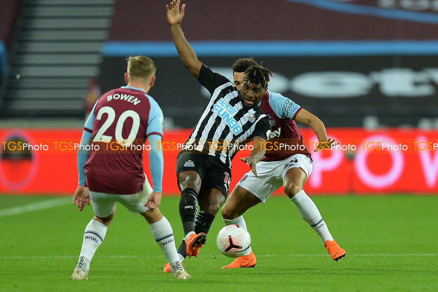 Allan Saint-Maximin of Newcastle United is tackled by Ryan Fredericks of West Ham United during West Ham United vs Newcastle United, Premier League Football at The London Stadium on 12th September 2020