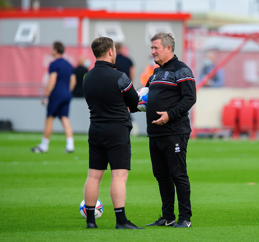 Lincoln City's first team development coach Richard O'Donnell, left, talks with Lincoln City's assistant manager David Kerslake during the pre-match warm-up<br /> <br /> Photographer Chris Vaughan/CameraSport<br /> <br /> The EFL Sky Bet League One - Saturday 12th September 2020 - Lincoln City v Oxford United - LNER Stadium - Lincoln<br /> <br /> World Copyright © 2020 CameraSport. All rights reserved. 43 Linden Ave. Countesthorpe. Leicester. England. LE8 5PG - Tel: +44 (0) 116 277 4147 - admin@camerasport.com - www.camerasport.com - Lincoln City v Oxford United
