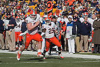 Syracuse center Macky MacPherson (59) leads the way for running back Antwon Bailey (29) to score on a 26-yard touchdown reception. The Pittsburgh Panthers beat the Syracuse Orange 33-20 at Heinz Field in Pittsburgh, Pennsylvania on December 3, 2011