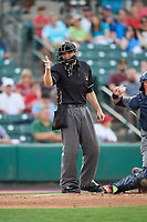 Home plate umpire Ryan Clark calls a strike during a game between the Lehigh Valley IronPigs and the Rochester Red Wings on June 29, 2018 at Frontier Field in Rochester, New York.  Lehigh Valley defeated Rochester 2-1.  (Mike Janes/Four Seam Images)