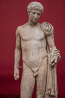 Delo, museo archeologico   Delos, archeological museum  statue of hermes, standing,wearing a chlamys that is wound around his left arm. In his right hand he held a purse and in his left the caduceus  Augustan period (27 DC-AD14) inspired by Lysippean original
