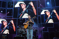 Dave Mathews sings to his hometown while bass player Steffan Lasard plays on the video screen behind Friday at the John Paul Jones Arena in Charlottesville, Va.