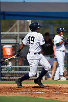 New York Yankees third baseman Dermis Garcia (49) follows through on a swing during an Instructional League game against the Baltimore Orioles on September 23, 2017 at the Yankees Minor League Complex in Tampa, Florida.  (Mike Janes/Four Seam Images)