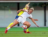 TOKYO, JAPAN - JULY 21: Lindsey Horan #9 of the USWNT is tackled during a game between Sweden and USWNT at Tokyo Stadium on July 21, 2021 in Tokyo, Japan.
