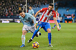 Yannick Ferreira Carrasco (r) of Atletico de Madrid vies for the ball with Nemanja Radoja of RC Celta de Vigo during their La Liga match between Atletico de Madrid and RC Celta de Vigo at the Vicente Calderón Stadium on 12 February 2017 in Madrid, Spain. Photo by Diego Gonzalez Souto / Power Sport Images