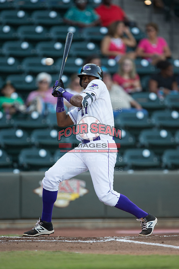 Eloy Jimenez (27) of the Winston-Salem Dash ducks away from a high and tight pitch during the game against the Potomac Nationals at BB&T Ballpark on August 5, 2017 in Winston-Salem, North Carolina.  The Dash defeated the Nationals 6-0.  (Brian Westerholt/Four Seam Images)