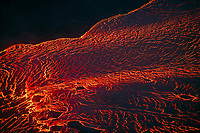 aerial view of lava originating from Kilauea Volcano, flowing as an incandescent river from fissure 8 in Leilani Estates subdivision, near Pahoa, toward Kapoho, Puna, Big Island, Hawaii, USA