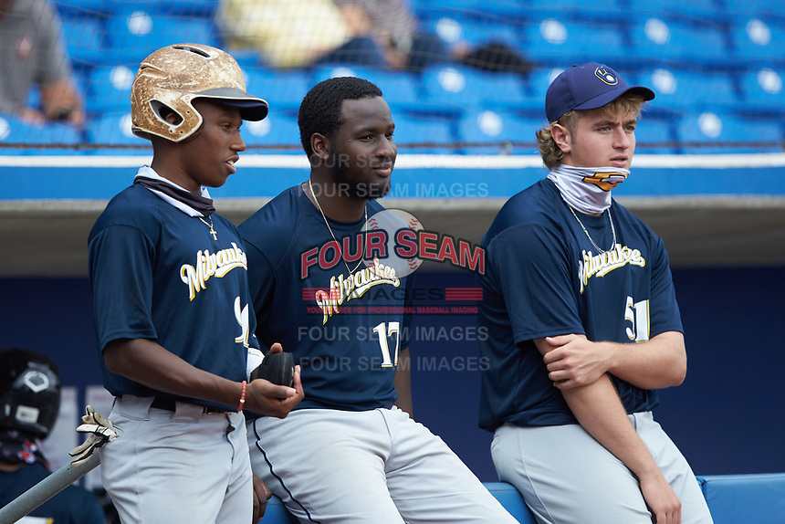 (L-R) Cam Pittman (90) of Nansemond River High School (VA), Kennedy Jones (17) of Maury High School (VA) and Wyatt Shenkman (51) of Riverside High School (VA) of the Milwaukee Brewers scout team watch from the dugout during game five of the South Atlantic Border Battle at Truist Point on September 27, 2020 in High Pont, NC. (Brian Westerholt/Four Seam Images)