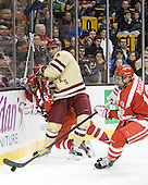 Sahir Gill (BU - 28), Tommy Cross (BC - 4), Wade Megan (BU - 18) - The Boston College Eagles defeated the Boston University Terriers 3-2 (OT) to win the 2012 Beanpot championship on Monday, February 13, 2012, at TD Garden in Boston, Massachusetts.