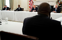 United States President Donald J. Trump makes remarks as he participates in a roundtable with law enforcement officials in the State Dining Room of the White House, in Washington, DC, Monday, June, 8, 2020. From left to right: US Attorney General William P. Barr, Attorney Daniel J, Cameron (Republican of Kentucky), President Trump and at right is Patrick Yoes, National President, Fraternal Order of Police President. <br /> Credit: Doug Mills / Pool via CNP/AdMedia