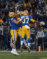 Pitt running back James Conner (middle) celebrates his record-setting touchdown. The Pitt Panther defeated the Duke Blue Devils 56-14 at Heinz Field in Pittsburgh, Pennsylvania on November 19, 2016.