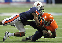 ATLANTA, GA - DECEMBER 31: Jonathon Mincy #6 of the Auburn Tigers tackles Kris Burd #18 of the Virginia Cavaliers during the 2011 Chick Fil-A Bowl at the Georgia Dome on December 31, 2011 in Atlanta, Georgia. Auburn defeated Virginia 43-24. (Photo by Andrew Shurtleff/Getty Images) *** Local Caption *** Kris Burd;Jonathon Mincy