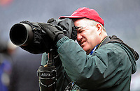 31 March 2011: Photographer Tim Cammett takes a photo prior to the Washington Nationals Opening Day festivities and game against the Atlanta Braves at Nationals Park in Washington, District of Columbia. The Braves shut out the Nationals 2-0 to open the 2011 Major League Baseball season. Mandatory Credit: Ed Wolfstein Photo
