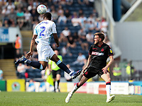 Blackburn Rovers' Ryan Nyambe heads clear under pressure from Bolton Wanderers' Craig Noone<br /> <br /> Photographer Andrew Kearns/CameraSport<br /> <br /> The EFL Sky Bet Championship - Blackburn Rovers v Bolton Wanderers - Monday 22nd April 2019 - Ewood Park - Blackburn<br /> <br /> World Copyright © 2019 CameraSport. All rights reserved. 43 Linden Ave. Countesthorpe. Leicester. England. LE8 5PG - Tel: +44 (0) 116 277 4147 - admin@camerasport.com - www.camerasport.com