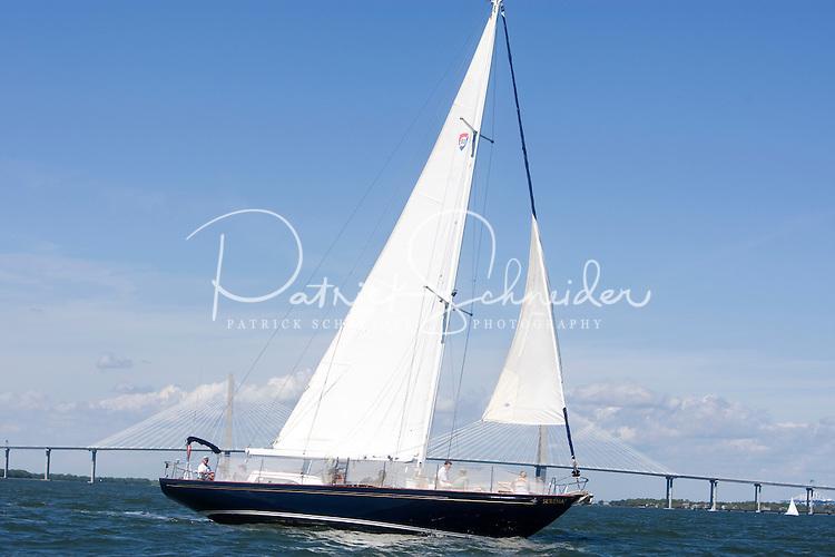 A sailboat cruises past the Cooper River Bridge in the Charleston Harbor in Charleston, SC.