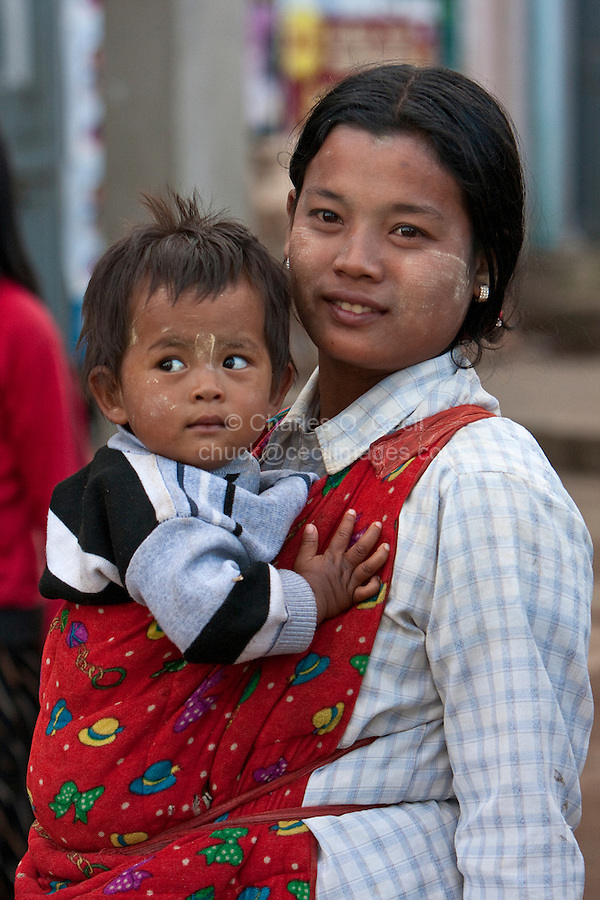 Myanmar, Burma.  Burmese Mother and Child, Pindaya, Shan State.  A light coating of thanaka paste is on their faces, a natural cosmetic sunscreen.
