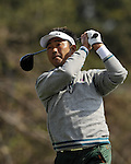 JEJU, SOUTH KOREA - APRIL 23:  Tetsuji Hiratsuka of Japan tees off on the 9th hole during the fog-delayed Round One of the Ballantine's Championship at Pinx Golf Club on April 23, 2010 in Jeju island, South Korea. Photo by Victor Fraile / The Power of Sport Images