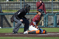 Virginia Tech Hokies catcher Dayne Leonard (41) blocks a pitch in the dirt as home plate umpire Ryan Clark looks on during the game against the Boston College Eagles at English Field on April 3, 2021 in Blacksburg, Virginia. (Brian Westerholt/Four Seam Images)