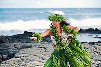 Kahiko hula dancer by the ocean, O'ahu.