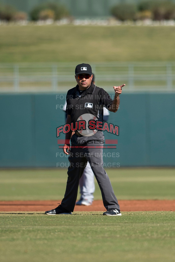 Field umpire Nestor Ceja during an Arizona Fall League game between the Surprise Saguaros and the Glendale Desert Dogs at Surprise Stadium on November 13, 2018 in Surprise, Arizona. Surprise defeated Glendale 9-2. (Zachary Lucy/Four Seam Images)