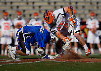 Brian McDermott (26) of Virginia fights for the face off with CJ Costabile (9) of Duke during the ACC men's lacrosse tournament semifinals in College Park, MD.  Virginia defeated Duke, 16-12.