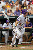 LSU Tigers outfielder Jake Fraley (23) follows through on his swing against the TCU Horned Frogs in the NCAA College World Series on June 14, 2015 at TD Ameritrade Park in Omaha, Nebraska. TCU defeated LSU 10-3. (Andrew Woolley/Four Seam Images)