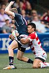 Ryuji Noguchi of Japan (R) puts a tackle on Alex McQueen of Hong Kong (L) during the Asia Rugby Championship 2017 match between Hong Kong and Japan on May 13, 2017 in Hong Kong, China. Photo by Marcio Rodrigo Machado / Power Sport Images