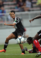 BOYDS, MARYLAND - July 21, 2012:  Lianne Sanderson (10) of DC United Women passes the ball away from Marbel Egwuenu (0) of the Virginia Beach Piranhas to Joanna Lohman (17) for the thirs goal during a W League Eastern Conference Championship semi final match at Maryland Soccerplex, in Boyds, Maryland on July 21. DC United Women won 3-0. DC United Women won 3-0.