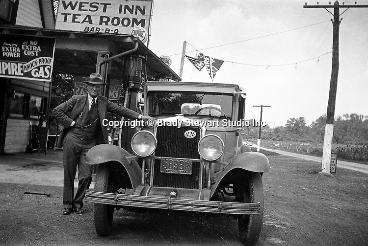 Western PA:  Brady Stewart standing next to his 1929 Chevy Coach after having lunch at the West Inn Tea Room.