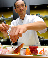 Milano Matsuri Festival 2014 - Il famoso chef giapponese Ikeda Osamu, impegnato nella preparazione di un piatto di sashimi.<br /> The famous Japanese chef Osamu Ikeda, engaged in the preparation of a plate of sashimi. <br /> Photo Livio Senigalliesi