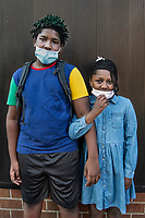 """5/3/20-New York, New York City in the time of Coronavirus. <br /> """"The weather was so nice they decided to dress springy for our essential run to Target,"""" mom told me when I commented how nicely dressed up her children looked and wondered if they were going somewhere special. Dressing up seems a thing of the past during these home-based days with fashion more likely lends itself to sweat pants.  <br /> """"They're being homeschooled for the rest of the year and not loving it, they miss their peers. Our shopping runs feel like a special occasion."""" Of course I had to ask about the green hair, a pandemic lock down look? """"No he did it for it the holidays, it was supposed to be blue!"""" A cool mom for sure but it's the obvious love and closeness she cultivated between this bother and sister that became most apparent when I asked to photograph them. """"I do try to raise them with a closeness and I'm glad they are growing well together."""" Well done. Happy mothers day to you and your family!"""