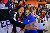 HOUSTON, TX - JANUARY 31: Carli Loyd #10 and fans of the United States celebrate with selfies during a game between Panama and USWNT at BBVA Stadium on January 31, 2020 in Houston, Texas.