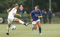 Duke University forward Laura Weinberg (16) eludes Boston College midfielder Coco Woeltz (2).Boston College (white) defeated Duke University (blue/white), 4-1, at Newton Campus Field, on October 6, 2013.