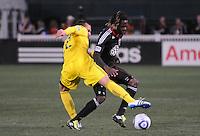 DC United forward Joseph Ngwenya (11) goes against midfielder Dejan Rusmir (22)   DC United defeated The Columbus Crew 3-1  at the home season opener, at RFK Stadium, Saturday March 19, 2011.