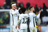 Nathan Dyer and Joe Rodon of Swansea City at full time during the Sky Bet Championship match between Swansea City and West Bromwich Albion at the Liberty Stadium in Swansea, Wales, UK. Saturday 07 March 2020