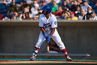 Harvin Mendoza (38) of the Kannapolis Cannon Ballers at bat against the Charleston RiverDogs at Atrium Health Ballpark on July 4, 2021 in Kannapolis, North Carolina. (Brian Westerholt/Four Seam Images)