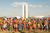 Indigenous warriors protest with their borduna war clubs and bows and arrows in front of the Congress building during a demonstration in Brasilia, Brazil by the Xicrin, Kayapo and Pataxo tribes, 10th November 2015. Photo © Sue Cunningham, pictures@scphotographic.com