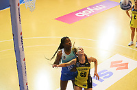 Grace Nweke and Katrina Rore in action during the ANZ Championship netball match between Northern Mystics and Central Pulse at the Auckland Netball Centre in Auckland, New Zealand on Saturday 18 July 2020. Photo: Simon Watts / bwmedia.co.nz