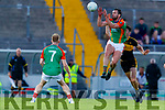 Ronan Murphy, Mid Kerry in action against David Shaw, Dr. Crokes during the Kerry County Senior Football Championship Semi-Final match between Mid Kerry and Dr Crokes at Austin Stack Park in Tralee, Kerry.