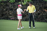 Paula Creamer bumps fists with Chris Yu during the World Celebrity Pro-Am 2016 Mission Hills China Golf Tournament on 23 October 2016, in Haikou, Hainan province, China. Photo by Weixiang Lim / Power Sport Images