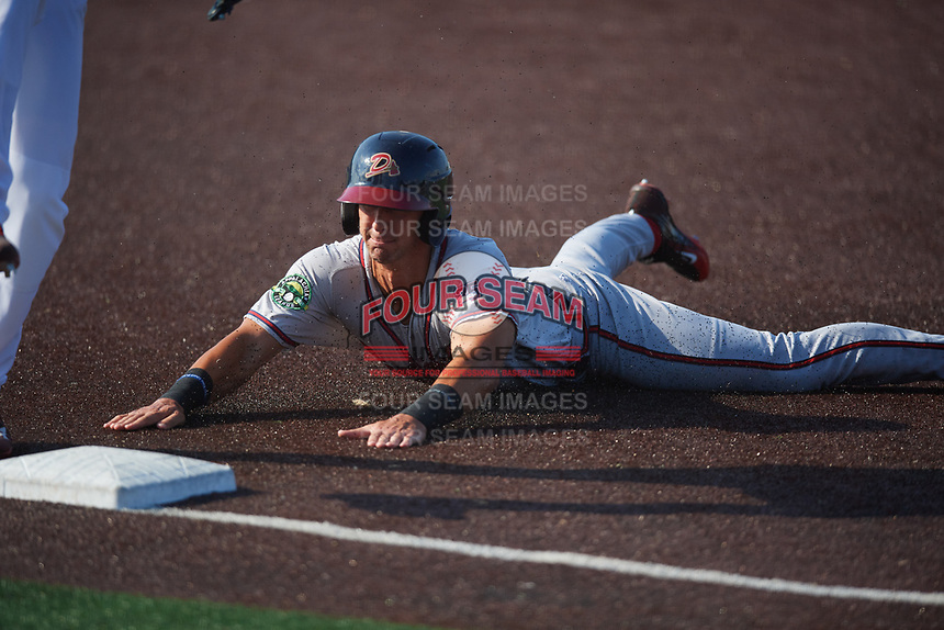 Danville Braves third baseman Brett Langhorne (23) slides into third base during a game against the Johnson City Cardinals on July 29, 2018 at TVA Credit Union Ballpark in Johnson City, Tennessee.  Johnson City defeated Danville 8-1.  (Mike Janes/Four Seam Images)
